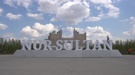outstanding : Just-Sultan Astana Light Blue Colored Welcome Billboard at Lovers Park on a Sunny Cloudy Blue Sky Day