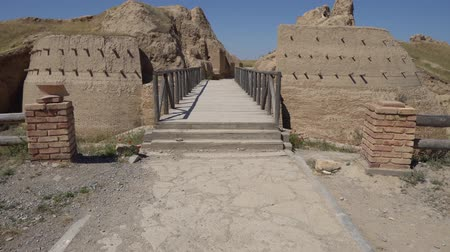 archeological : Turkestan Sauran Main Bridge Gate Entrance View of the Archeological Site on a Sunny Blue Sky Day