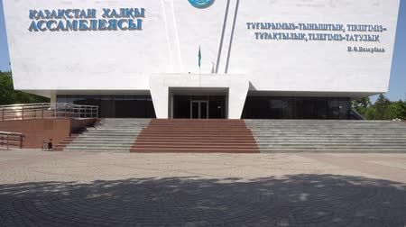 культурный : Shymkent Abay Park Kazakhstan Folk Ensemble Building Frontal View Waving Kazakh Flag on a Sunny Blue Sky Day
