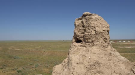 archeological : Turkestan Sauran Ancient City Walls Tower Outpost with Breathtaking View of Yurt on a Blue Sky Blue Day Stock Footage