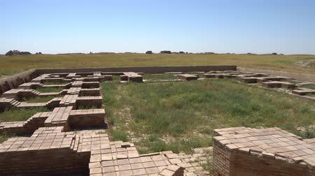 archeological : Turkestan Sauran Palace or Temple Foundation Ruins of the Archeological Site on a Sunny Blue Sky Day Stock Footage