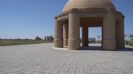 temyiz : Turkestan Arystan Bab Mausoleum Brick Pavilion with Golden Cupola Mausoleum at a Sunny Blue Sky Day