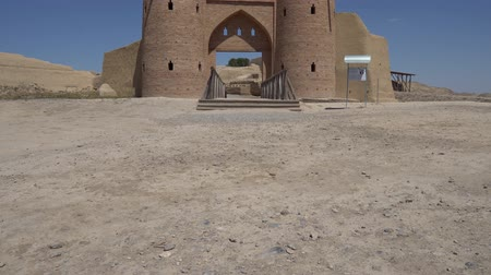 霊廟 : Turkestan Otrartobe Archeological Site Front View of Main Gate Entrance and Bridge to the Ancient City on a Sunny Blue Sky Day