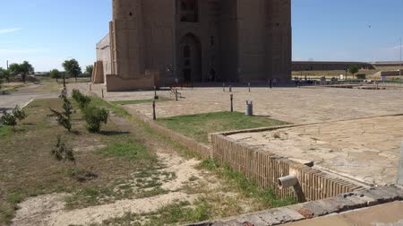 költő : Turkestan Mausoleum of Khoja Ahmed Yasawi Breathtaking Side View with People Walking on a Sunny Blue Sky Day