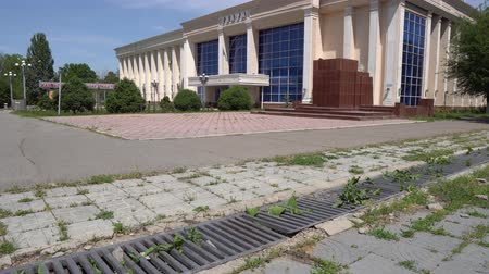 temyiz : Taraz Kazakh Drama Theater Picturesque Side View at Abay Avenue with Trees on a Sunny Blue Sky Day Stok Video
