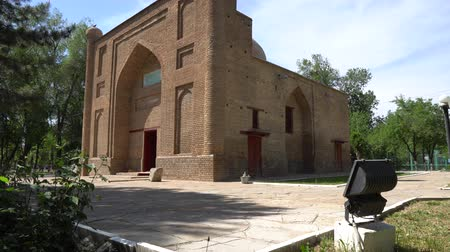 temyiz : Taraz Karakhan Mausoleum Picturesque Side View of the Main Entrance with Park Tree on a Sunny Blue Sky Day