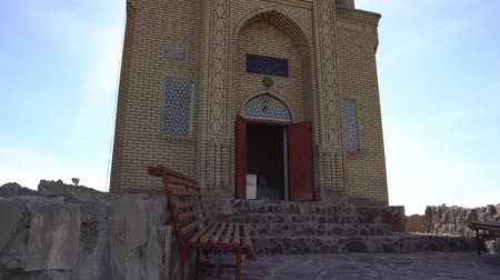 khan : Taraz Tekturmas Mausoleum Low Angle View of the Open Doors Entrance with Blue Colored Cupola on a Blue Sky Sunny Day Stock Footage