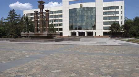polinésia : Taldykorgan Akimat City Hall of Almaty Frontal View with Waving Kazakh Flag and Fountain at Blue Sky Day Stock Footage