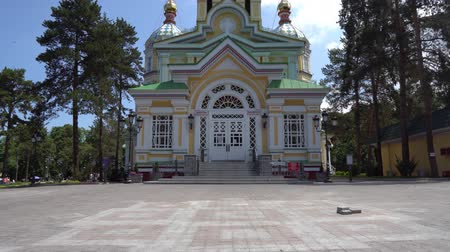 silk road : Almaty Russian Orthodox Christian Zenkov Ascension Cathedral of the Lord Back Entrance View at Panfilov Park on a Sunny Blue Sky Day
