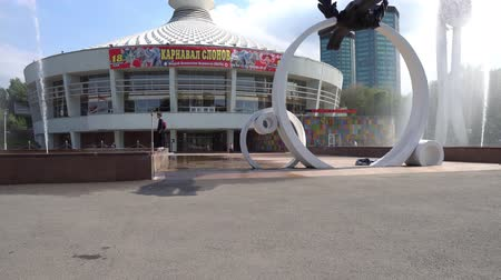 Almaty Kazakh State Circus View of Fountains and Sculpture of a Leopard Jumping on a Cloudy Blue Sky Day Stock Footage