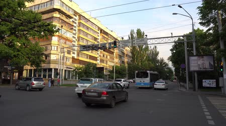Almaty Abay Street Crossroads Traffic Lights Turning on Red for the Cars and Pedestrians are Crossing the Road on a Cloudy Cloudy Blue Sky Day Stock Footage