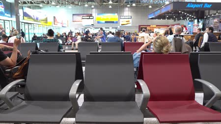 Almaty International Airport Three Empty Seats at the Departure Gate while on a smartphone
