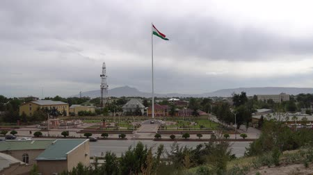 Qurghonteppa Bokhtar High Angle View of Waving Tajikistan Flag on a Flagpole near Vakhdat Avenue on a Cloudy Rainy Day