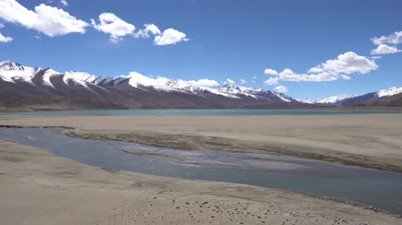 kul : Pamir Highway Yashilkul Breathtaking Lake Picturesque View with Snow Capped Mountains on a Sunny Blue Sky Day