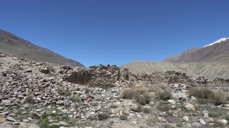 citadela : Pamir Highway Ratm Fort Ruins Wakhan Corridor View with Snow Capped Mountains on a Sunny Blue Sky Day