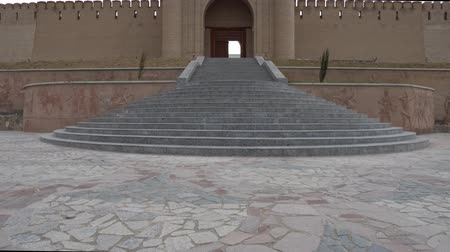 tajik : Istaravshan Kalai Mug Teppe Fortress Low Angle View with Stairs and Main Gate Entrance on a Cloudy Rainy Day