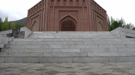 edebi : Panjrud Abu Abdullah Rudaki Mausoleum Low Angle View of the Main Entrance Doors on a Cloudy Rainy Day