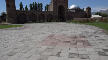 caravanserai : Hisor Fortress Madrasa Caravanserai Main Gate Entrance View on a blue sky day Stock Footage