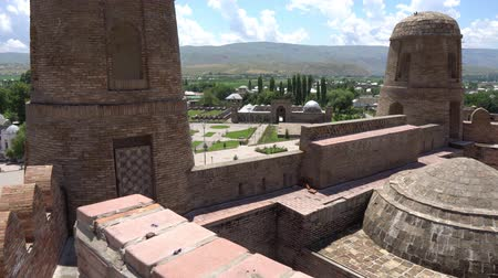 caravanserai : Hisor Fortress High Angle Watchtowers and Madrasa Caravanserai on a Sunny Blue Sky Day