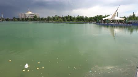 tajik : Dushanbe Flagpole Park Lake Duckling at Duckling and Palace of Nations on a Cloudy Rainy Day