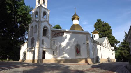 gods : Dushanbe Russian Orthodox Christian Saint Nicholas Cathedral Low Angle Frontal View on a Sunny Blue Sky Day