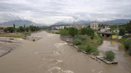 tajik : Dushanbe Streaming Varzob River View from the Ismoil Somoni Avenue Bridge on a Cloudy Rainy Day