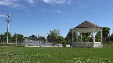 tajik : Dushanbe Youth Park Frontal View of Pavillion with Sparkling Fountain on a Sunny Blue Sky Day