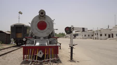 temyiz : Sukkur Main Railway Station View of Locomotive and Frontal Gate View Waving Pakistan Flag on Roof on a Blue Sky Sunny Day Stok Video