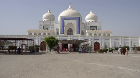 exiting : Larkana Bhutto Family Mausoleum Frontal View with People Enjoying a Sunny Blue Sky Day Stock Footage
