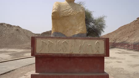 dead valley : Larkana Mohenjo Daro Archaeological  Site Priest King Statue on a Sunny Blue Sky Day Stock Footage