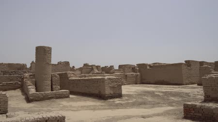 archeological : Larkana Mohenjo Daro Archaeological UNESCO World Heritage Site Tall Well on a Sunny Blue Sky Day Stock Footage