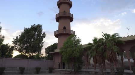 sindhu : Hyderabad Eidgah Masjid Mosque Picturesque Low Angle View of Minaret Surrounded by Trees and Clipped Hedges During Sunset