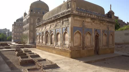 infante : Hyderabad Tombs of the Talpur Mirs Mausoleum Containing Graves of Two Females and Infant Side View During Sunrise Stock Footage