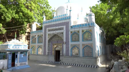 surroundings : Hyderabad Sarfaraz Khan Kalhoro Shrine Side View with Surrounding Grave on a Sunny Blue Sky Day Stock Footage