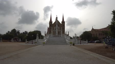roman : Karachi Roman Catholic Saint Patricks Cathedral Front View with Flying Birds on a Cloudy Rainy Day Stok Video