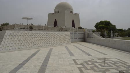 muhammad ali : Karachi Mazar-e-Quaid Jinnah Mausoleum Frontal View with Empty Fountain and Flying Birds on a Cloudy Day