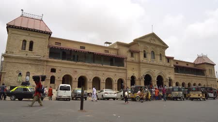 Karachi Main Railway Cantonment Station Fronting Main Gate Entrance with Passing People and Rickshaws on a Cloudy Day