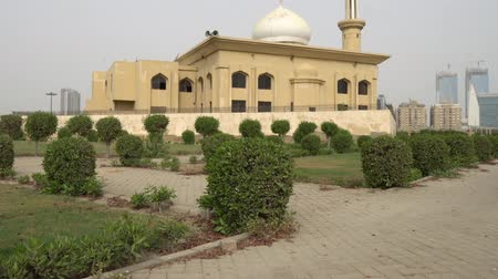 Karachi Bagh Ibn e Qasim Park Ashrafi Masjid Mosque Side View with Clipped Hedges on a Cloudy Day Stock Footage