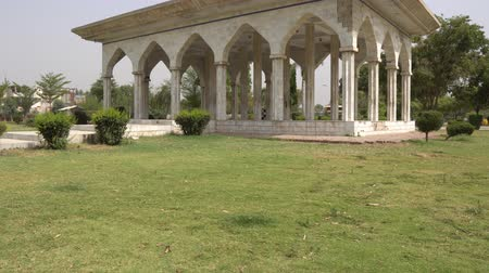 Multan Shah Shams Park Pavilion Side View at Eidgah Road with Clipped Hedges on a Sunny Blue Sky Day
