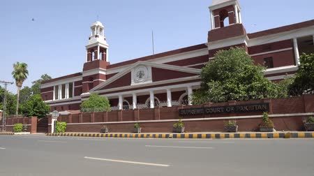 jurisdiction : Lahore Supreme Court of Pakistan Side View at Ustad Allah Bakhsh Road on a Sunny Blue Sky Day