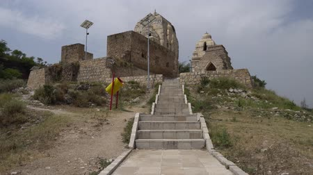 plateau : Chakwal Qila Katas Raj Hindu Temples Dedicated to Shiva with One of Many Shrines on a Sunny Blue Sky Day