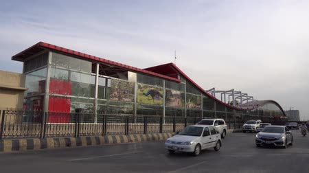 metropolitano : Islamabad Rawalpindi Metro Bus Station Centaurus South at Blue Area with Busy Traffic and Driving Cars at Sunset Stock Footage