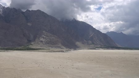 silk road : Shigar Katpana Cold Desert Valley with Snow Capped Mountains on a Sunny Blue Sky Day