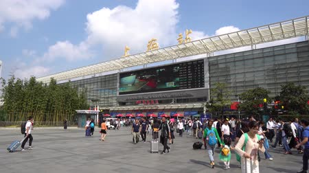 gongyuan : Shanghai Railway Station Nanchang South Square with People Walking during Golden Week Holiday National Day of Peoples Republic of China
