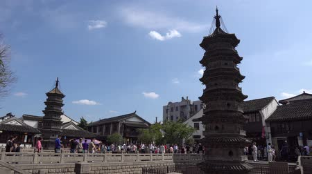 gongyuan : Shanghai Nanxiang Old Town Canal City Picturesque Stone Pagoda with People Walking on a Sunny Blue Sky Day