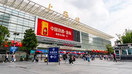 gongyuan : TIMELAPSE Shanghai Railway Station Nanchang South Square with People walking during Golden Week National Day of Peoples Republic of China