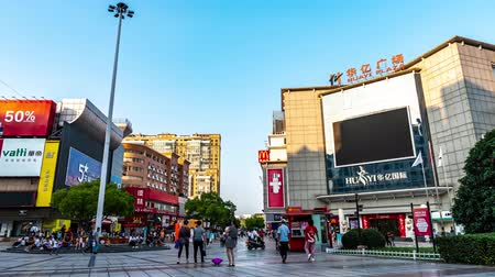 yangtze : TIMELAPSE Wuhu Anhui Zhongshan Buxingjie Pedestrian Road View of the Main Square with Walking People During Sunset