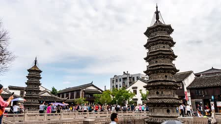 látvány : TIMELAPSE Shanghai Nanxiang Old Town Canal City Picturesque Stone Pagoda with People Walking on a Sunny Blue Sky Day Stock mozgókép