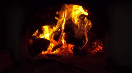 charred : Slow motion fire flames in fireplace. Bonfire and coals close-up. Stock Footage
