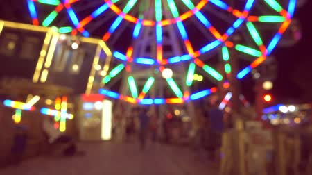 karnaval : Beautiful amusement park at night, ferris wheel and carousel,  defocused video. Stok Video